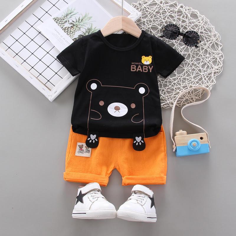 Black shirt & orange contrast shorts